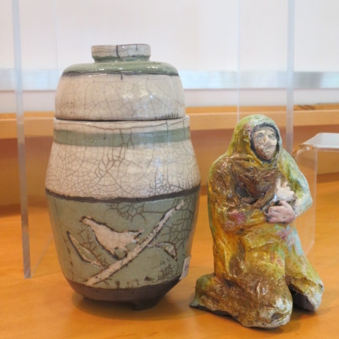 Lidded Green Pot and Homeless Man with Cat